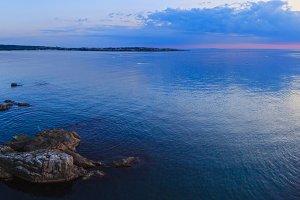 Sea coastline sunrise panorama.