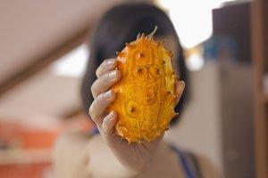 Woman holding exotic fruit
