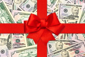 Red gift ribbon bow and US dollars