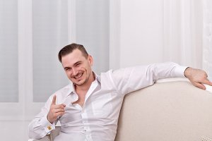 Male model in white shirt. Joking