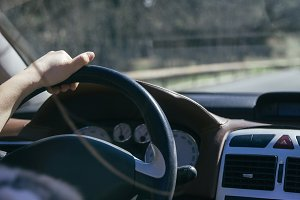 Hand of a woman driving a car