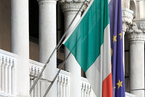 Flags of Italy, and the European Union in Venice, Italy.