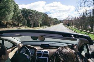 Women in a convertible car