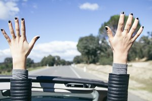 Hands in the air in a cabriolet car