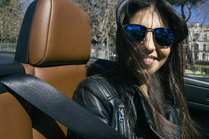 Woman with sunglasses in a car