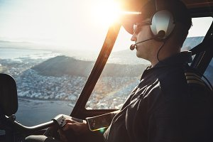 Male helicopter pilot flying