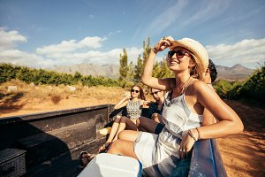 Young friends sitting in a pickup