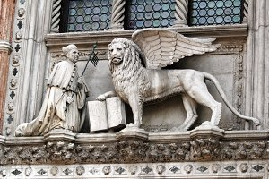 Statue of the Venetian Doge and Lion on the facade the Doge's Palace in Venice, Italy.