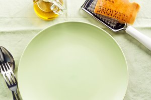 empty plates on a tablecloth