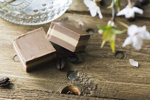 Chocolate bonbon, on rustic table