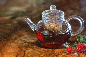 Herbal tea in a glass tea pot