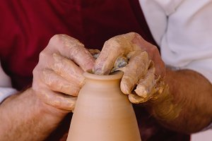potter hands making a clay pot