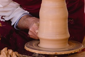 potter working in a vase