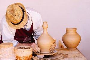 working potter using kick wheel