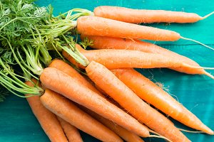 Carrots on green background