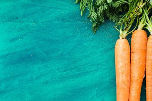 Green background with carrots