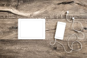 Digital devices on wooden background