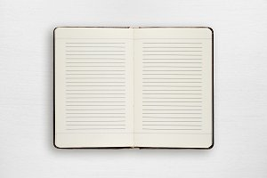 Open diary on white wooden table