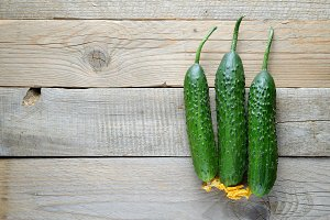 Cucumbers on old wooden background