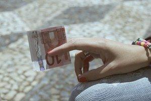 Hand Holding Euro Bill