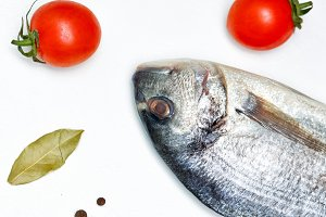Still life. Food. Tomatoes and fish.