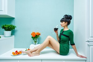 Girl drinking wine at home.