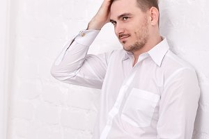Male model in white shirt.