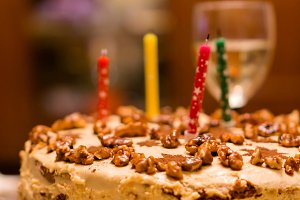 Birthday cake with nuts and candles