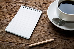 Notepad with hot coffee