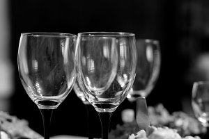 Glasses on festive table b/w
