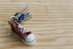 Key chain on wooden background