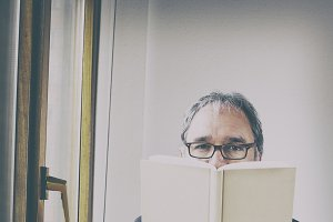 Man looking at a book