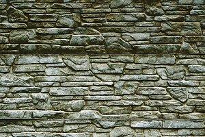 Dark green stone brick wall