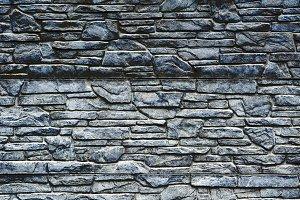 Dark blue stone brick wall