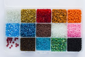 Multicolored beads in a plastic container