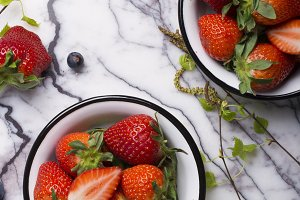 Strawberry on a white marble background