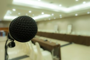 Black microphone in hall.