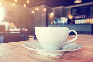 A white cup of coffee in cafe.