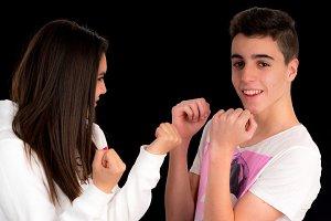 Teenage couple imitating a fight II