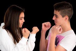 Teenage couple imitating a fightIII