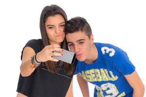 Teenagers couple by making selfies