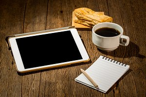 Blank tablet and coffee