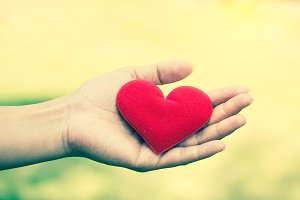 Hand hold red heart