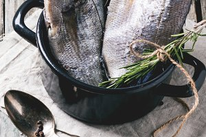 Tow raw dorado fish with rosemary