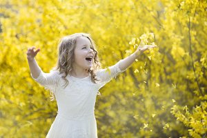 Pretty girl  and blooming forsythia