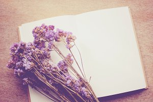 Blank notebook and dried flower
