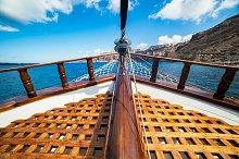 Ship cruising to Santorini island.