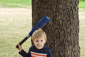 Boy with Bat and Ball Making a Face