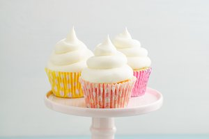Three cupcakes on cake stand