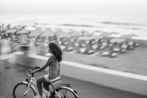 A young woman is cycling (Black and white)